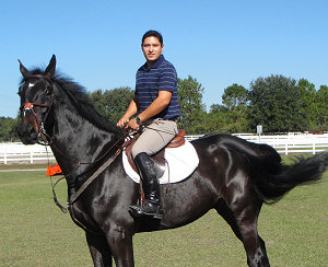 Roberto with his gelding Chelzy. Chelzy is now enjoying the beautiful weather in Florida.