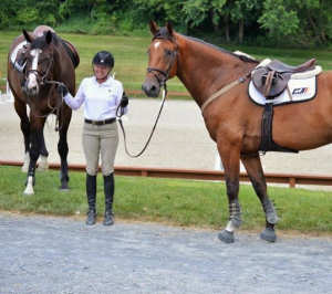 Cherie with her two successful show jumpers. Discovered at the GHC partner stables.