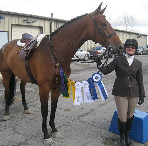 Pam with her Hunter Freeda. She went to the first horse show in April and competed in the low hunter classes. As you can see, the judge liked her a lot! Congratulations!