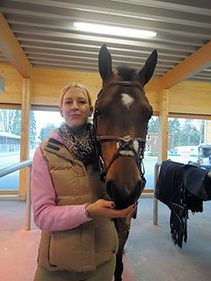 Vanessa with her show jumping mare Queluz.
