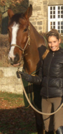 Anke with her show jumping prospect Prophan.